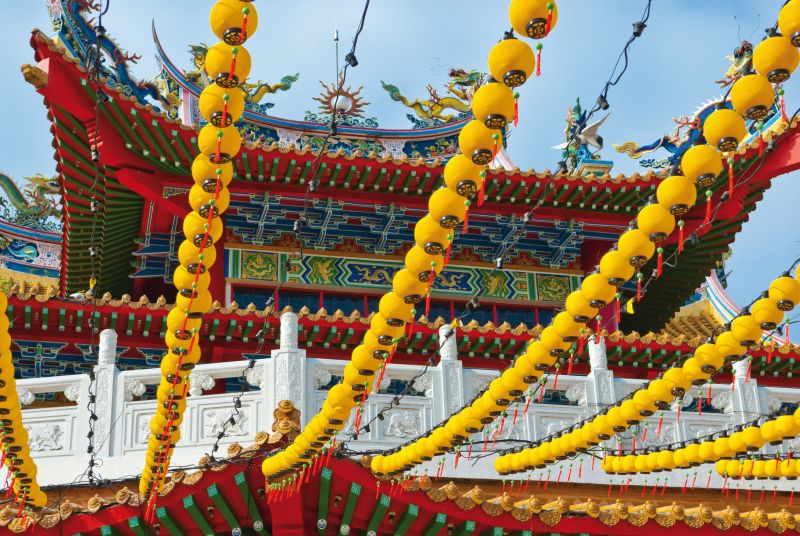 Yellow Lanterns Hanging on Temple Roof